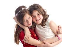 Twee het Mooie Zusters geïsoleerd koesteren Royalty-vrije Stock Foto's