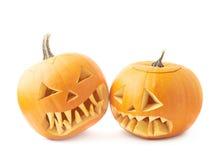 Twee Jack-o'-lanterns pompoenhoofden Royalty-vrije Stock Foto's