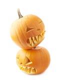 Twee Jack-o'-lanterns pompoenhoofden Stock Fotografie