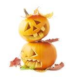 Twee Jack-o'-lanterns pompoenhoofden Royalty-vrije Stock Afbeeldingen