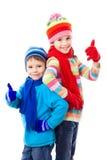 Twee jonge geitjes in de winterkleren Royalty-vrije Stock Afbeeldingen