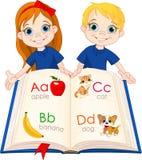 Twee jonge geitjes en ABC-boek Royalty-vrije Stock Afbeelding