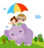 Twee jonge geitjes met paraplu en olifant Stock Foto's
