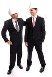 Twee jonge Ingenieurs die een overeenkomst voltooien Stock Foto's
