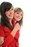 Twee jonge meisjes die op wit worden geïsoleerdi Royalty-vrije Stock Fotografie