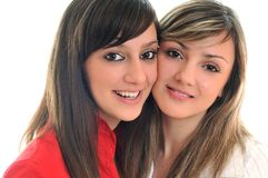 Twee jonge meisjes die op wit worden geïsoleerdn Stock Foto
