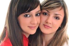 Twee jonge meisjes die op wit worden geïsoleerdn Royalty-vrije Stock Afbeelding