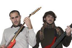 Twee jonge mensen met elektrische gitaren Royalty-vrije Stock Foto's