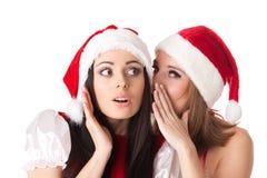 Twee jonge vrouwen in het kostuum van de Kerstman Stock Foto