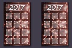 Twee kalenders met abstracte bokehachtergrond in het jaar van 2017 Stock Afbeelding