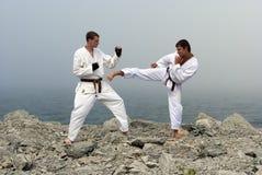 Twee karatekastrijd Stock Foto