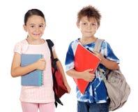 Twee kinderenstudenten die aan school terugkeren royalty-vrije stock afbeeldingen
