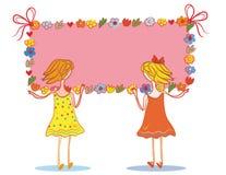 Twee kindmeisjes met banner Stock Afbeeldingen