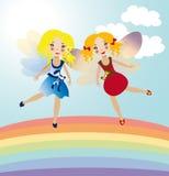 Twee kleine feeën in de regenboog Stock Foto