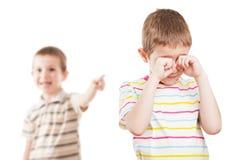 De kinderen in conflict maken ruzie Royalty-vrije Stock Foto