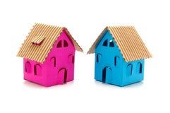twee kleurenplattelandshuisjes Stock Afbeeldingen