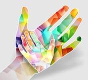 Twee kleurrijke handen Stock Foto
