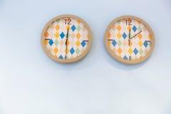 Twee kleurrijke klokken Stock Foto
