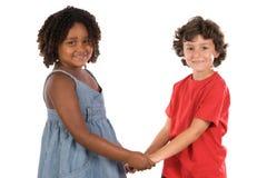 Twee knappe kinderen van verschillende rassen royalty-vrije stock afbeelding