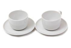 Twee koffiekoppen op wit Stock Foto