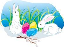 Twee konijnen van Pasen met eieren Stock Afbeelding