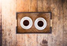 Twee Kop van koffie op een houten lijst Stock Afbeelding