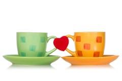 Twee koppen met rood hart Stock Foto