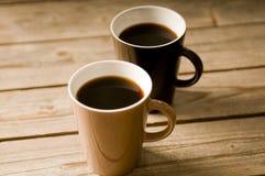 Twee Koppen van koffie met ondiepe DOF Royalty-vrije Stock Afbeelding