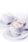 Twee koppen van koffie met slagroom Stock Foto's