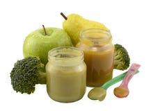 Twee kruiken van het babyvoedsel met lepels Stock Afbeelding
