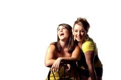 Twee lachende dames stock afbeeldingen