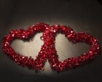 Twee lezen Valentine Hearts Royalty-vrije Stock Afbeeldingen