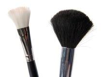Twee make-upborstel Stock Foto's