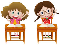 Twee meisjes die in klasse bestuderen stock illustratie