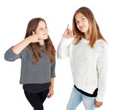 Twee meisjes die telefoneren me Stock Fotografie