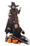 Twee meisjes in Halloween kostuums Stock Fotografie