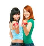 Twee meisjes met appelen Stock Afbeelding