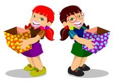 Twee meisjes met een doos Royalty-vrije Stock Afbeeldingen