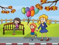 Twee meisjes met een jong geitje die een ballon in het park houden royalty-vrije illustratie