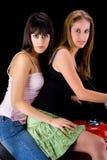 Twee meisjes op fiets stock fotografie