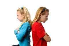 Twee meisjes zijn boos bij elkaar Stock Afbeelding