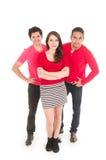 Twee mensen en een jong meisje kleedden zich in het rode stellen Royalty-vrije Stock Afbeelding