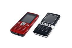 Twee mobiele telefoons Stock Foto's