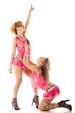 Twee mooi dansersmeisje in geïsoleerdg roze Stock Fotografie