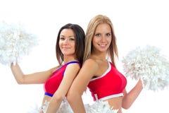 Twee mooie dansersmeisjes van het cheerleading van team Stock Afbeeldingen