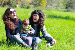 Twee mooie meisjes met een baby royalty-vrije stock foto