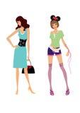Twee mooie meisjes in modieuze kleding Royalty-vrije Stock Foto