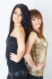 Twee mooie vrouwen die samen stellen royalty-vrije stock foto