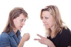 Twee mooie vrouwen spelen rots, document, schaar Stock Fotografie