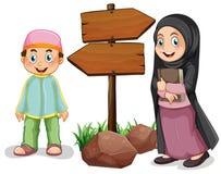Twee moslimjonge geitjes en houten tekens stock illustratie